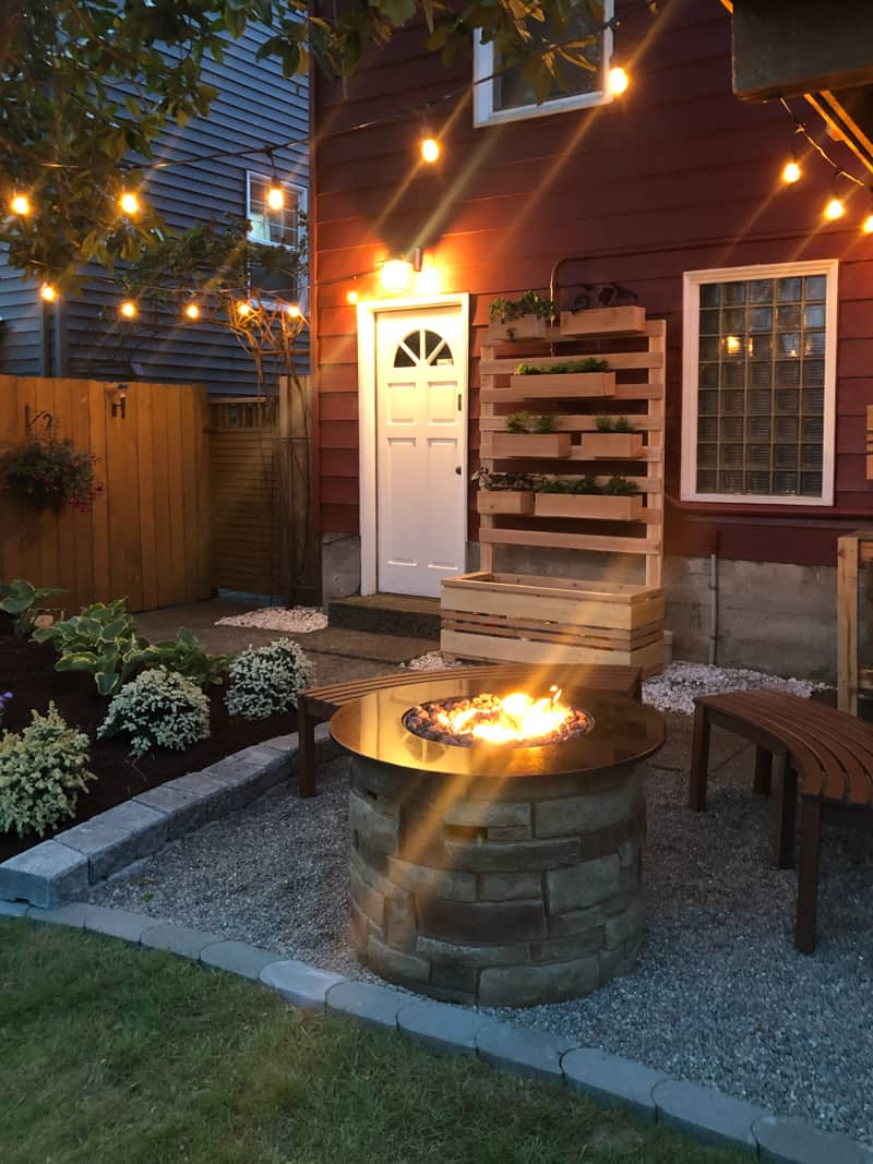 backyard makeover with string lights and propane fire pit