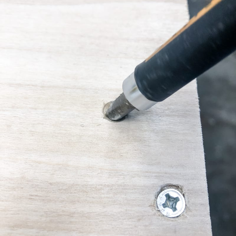 using a Philips head drill bit to create a countersink hole