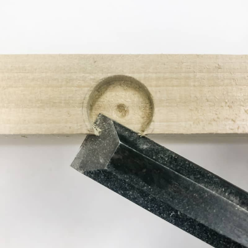 cutting bottom of opening for figure 8 table top fastener