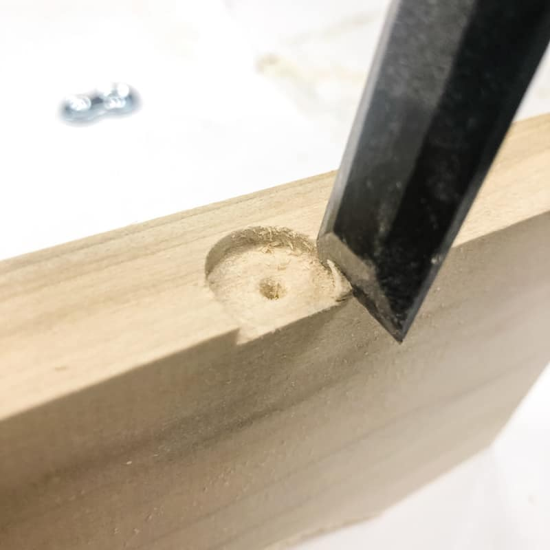 chiseling away corners of slot for table top fastener