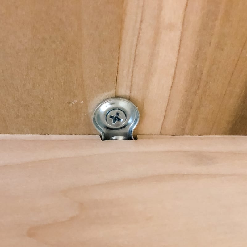 table top screwed in place with figure 8 fasteners