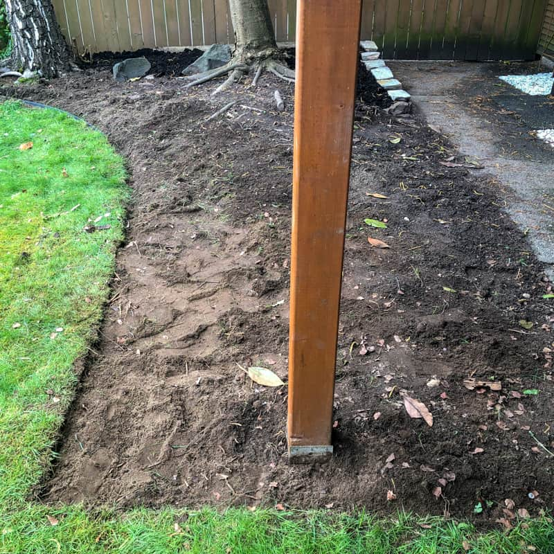 grass removed from pea gravel patio area
