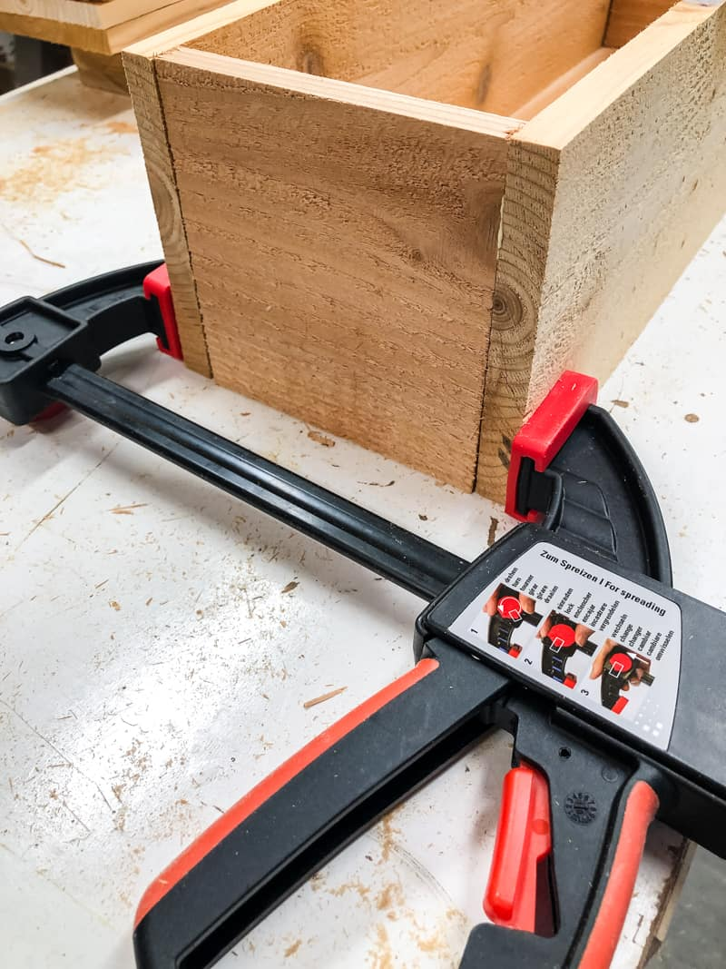 Bessey clamp holding together planter box