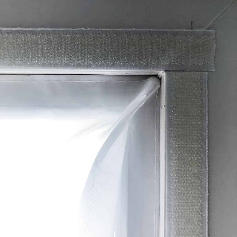 attaching casement window air conditioner seal to window frame with velcro
