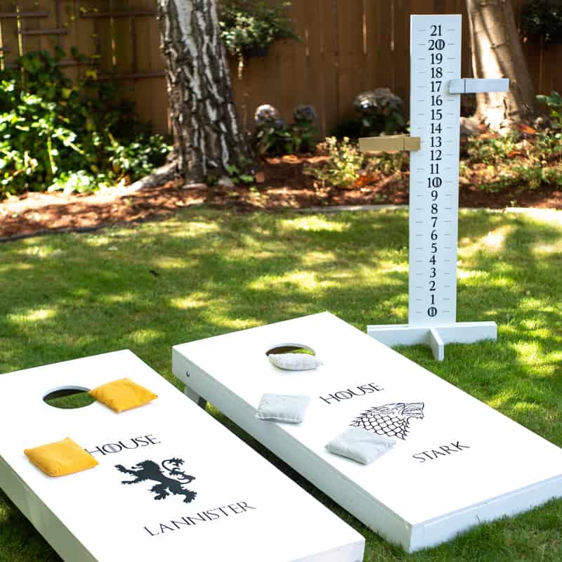 DIY cornhole boards with cornhole scoreboard featuring a Game of Thrones theme