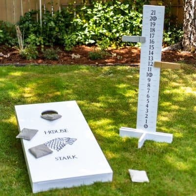 DIY cornhole scoreboard with cornhole board in Game of Thrones theme
