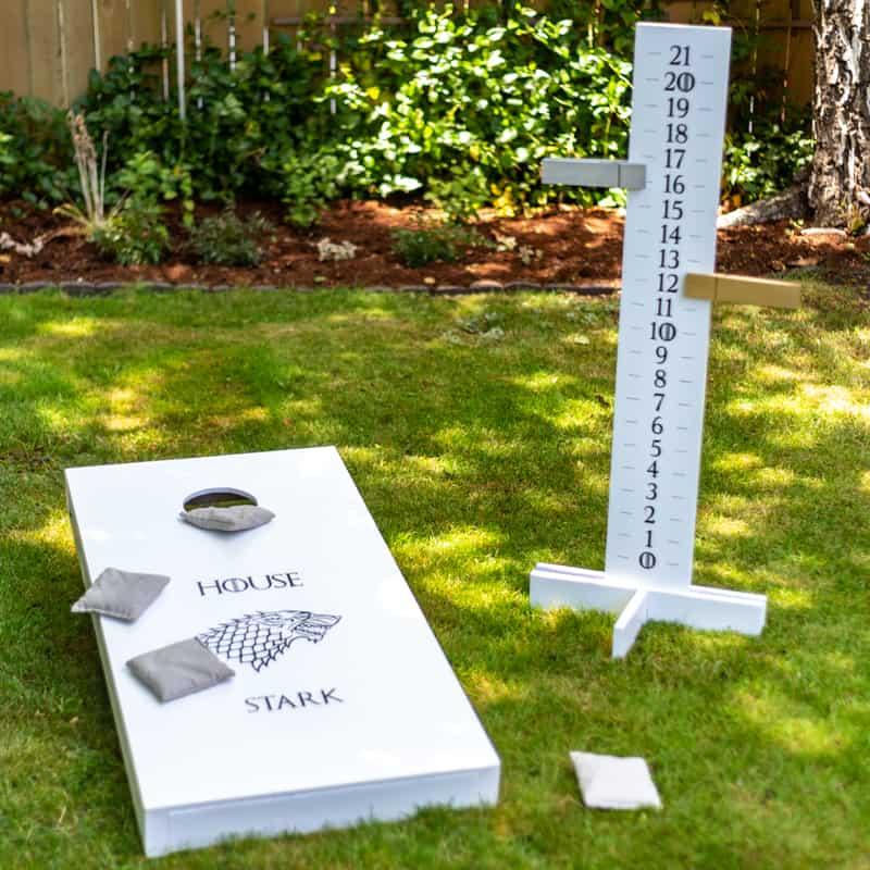 DIY cornhole scoreboard with cornhole board in Game of Thrones theme