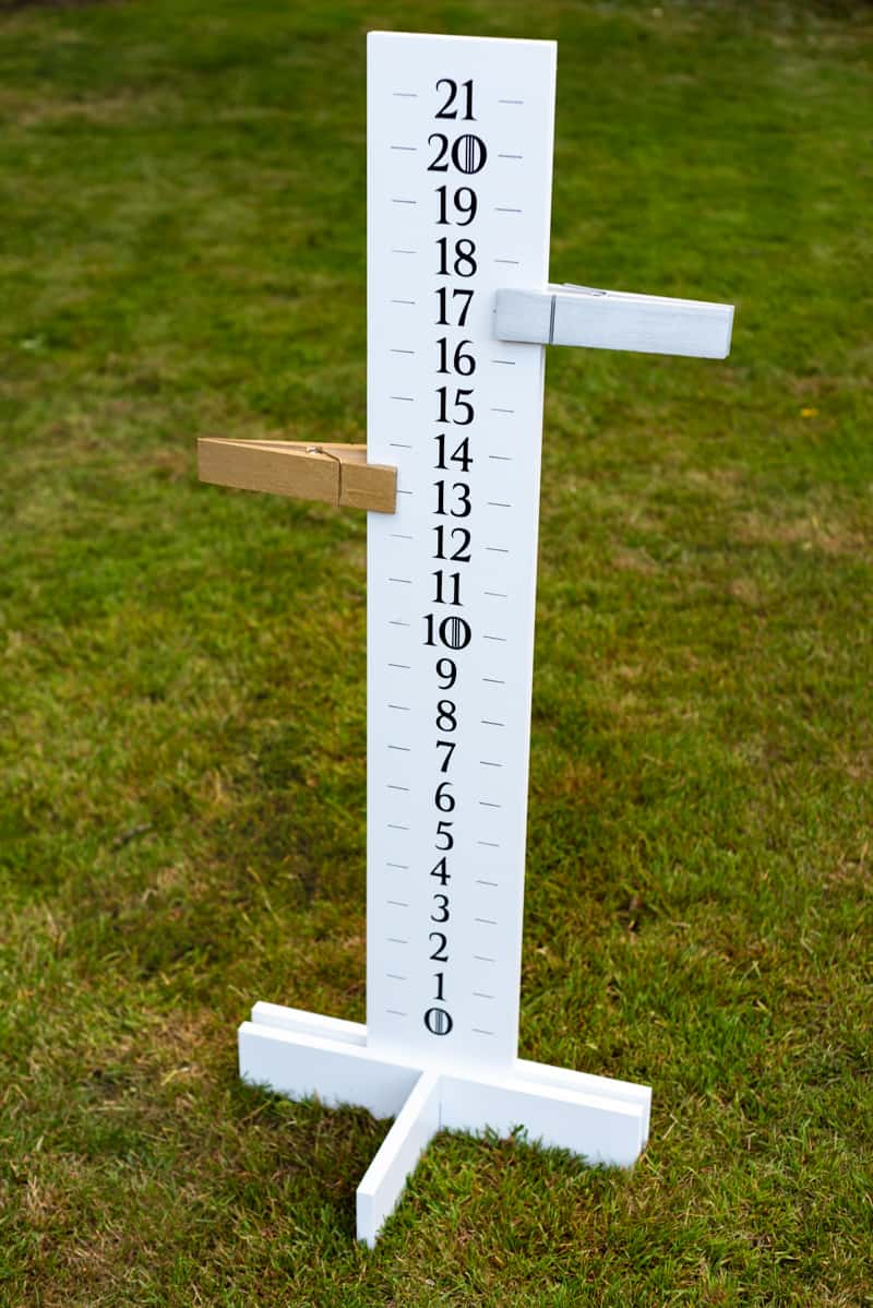 DIY cornhole scoreboard in backyard