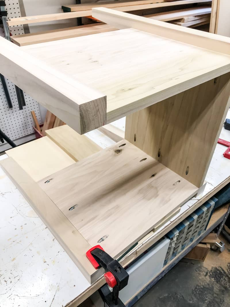 attaching the last panel of the DIY nightstand