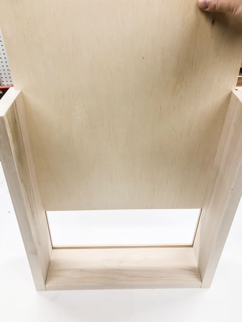 sliding drawer box bottom into place