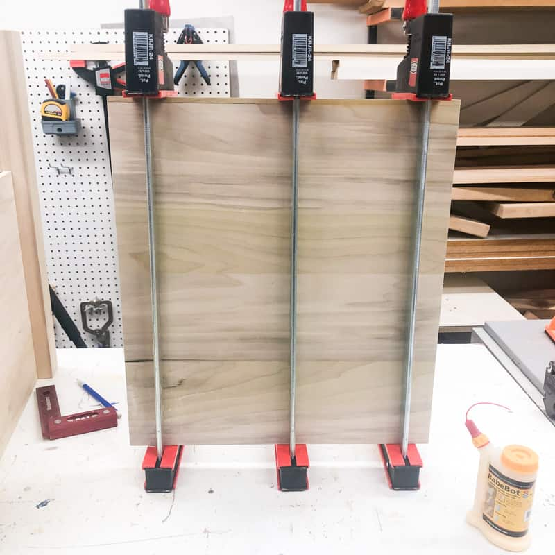 glue up of panels for DIY nightstand in Bessey clamps