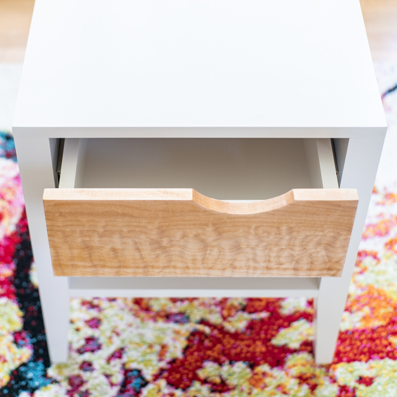 DIY nightstand with notched drawer front with drawer partially open