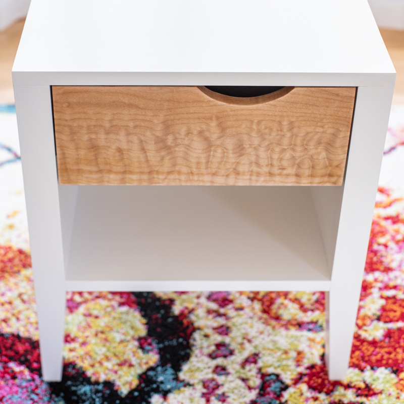 front view of DIY nightstand with white frame and curly maple drawer front