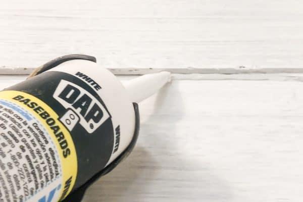 caulking gap in wood paneling before painting