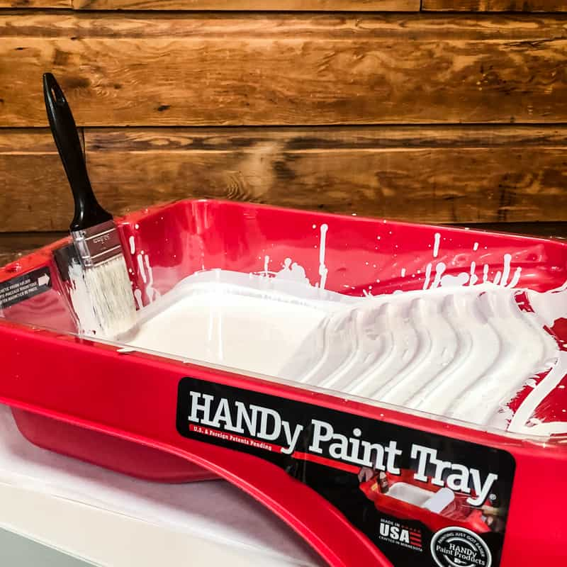 HANDy Paint tray holding white paint and paint brush