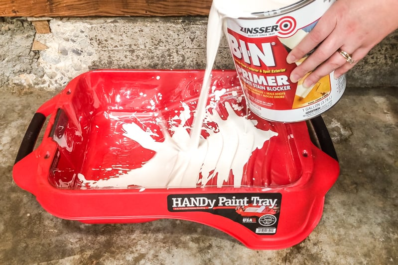 pouring primer into HANDy paint tray