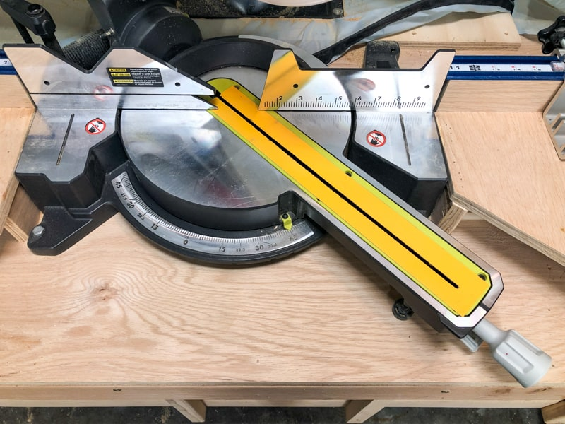 miter saw base set to 45 degrees for mitered cut