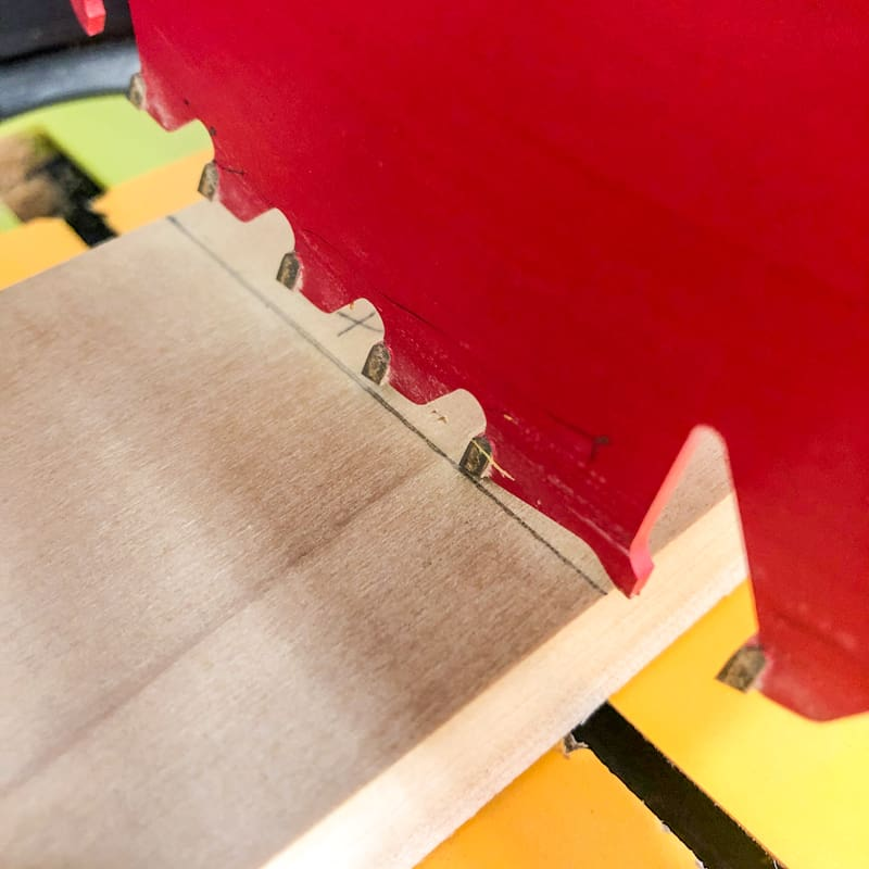 checking miter saw blade on cut line