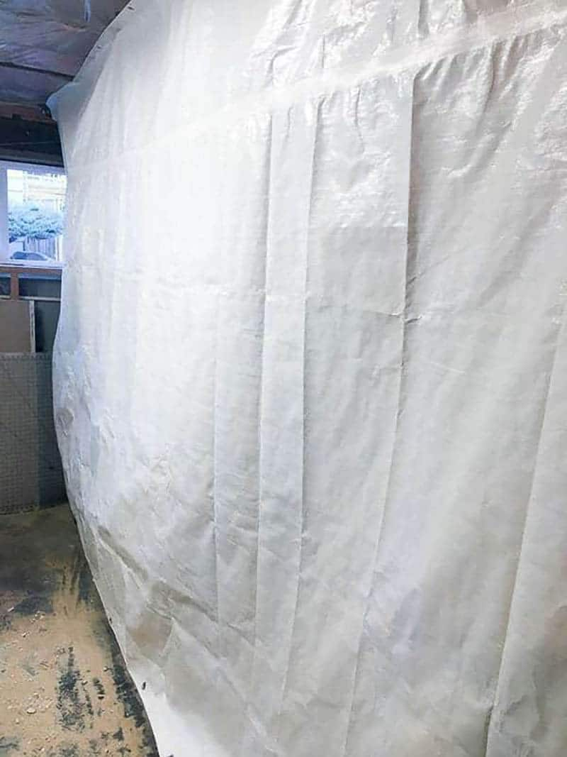 white tarp covering part of a room