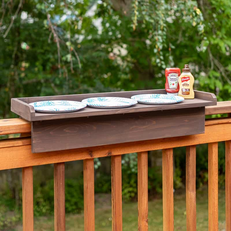 DIY balcony railing table with plates