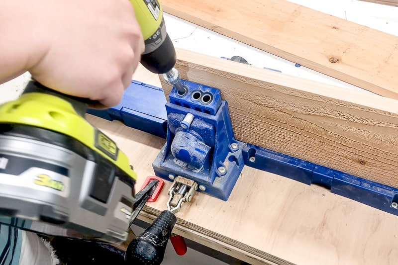 drilling pocket holes along the length of one board for the balcony railing table