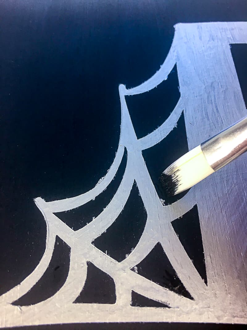 touching up stencil paint with an artist brush