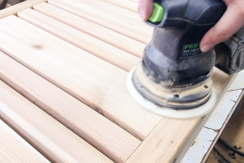 sanding slats of DIY coffee table