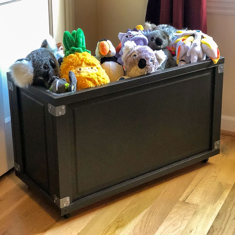 DIY rolling toy box filled with stuffed animals