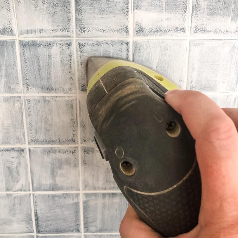 corner cat sander on painted backsplash tile to smooth out primer