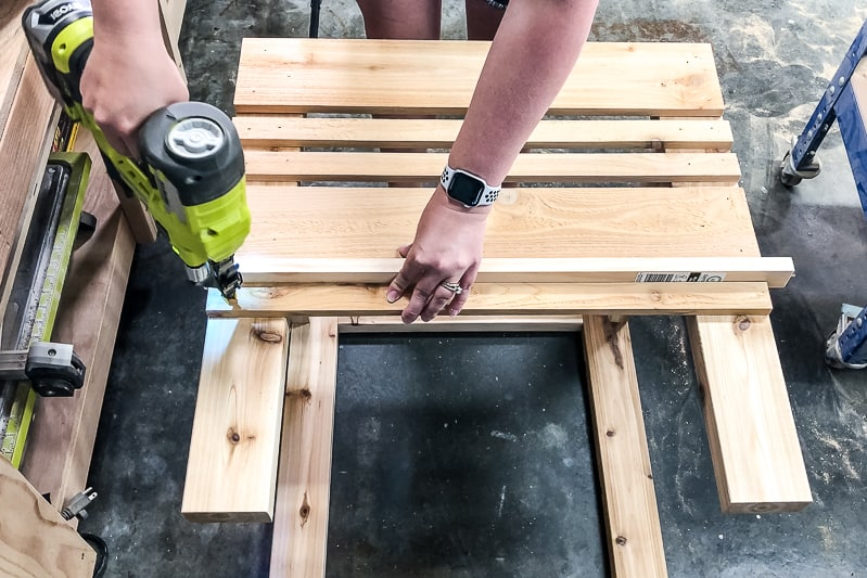 attaching slats to sides of umbrella stand table base with brad nails