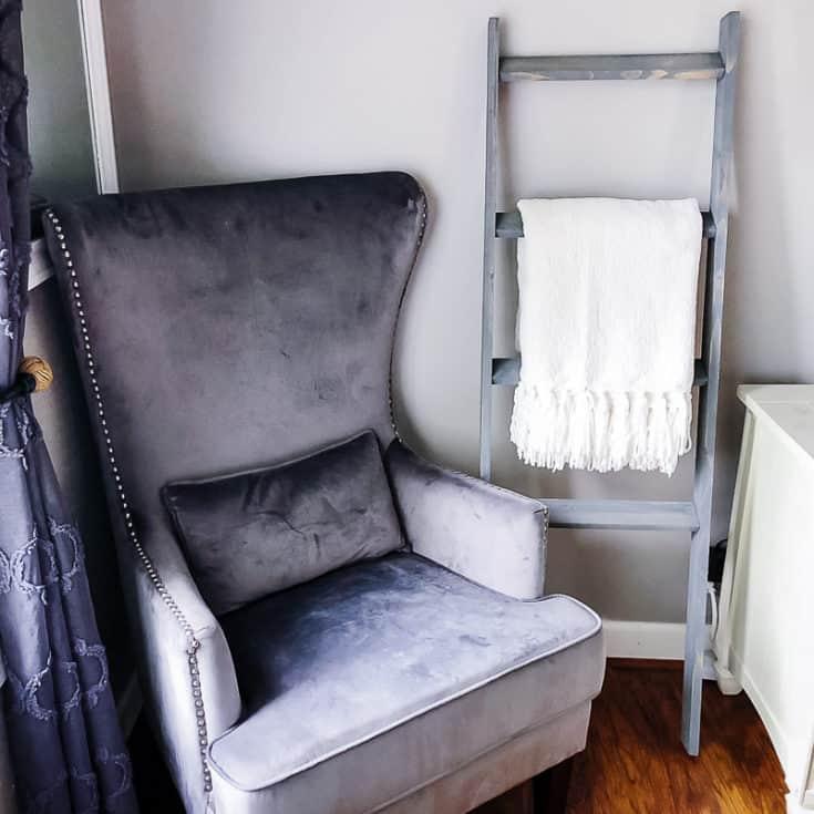 DIY blanket ladder next to armchair