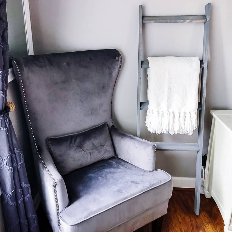 DIY blanket ladder next to armchair