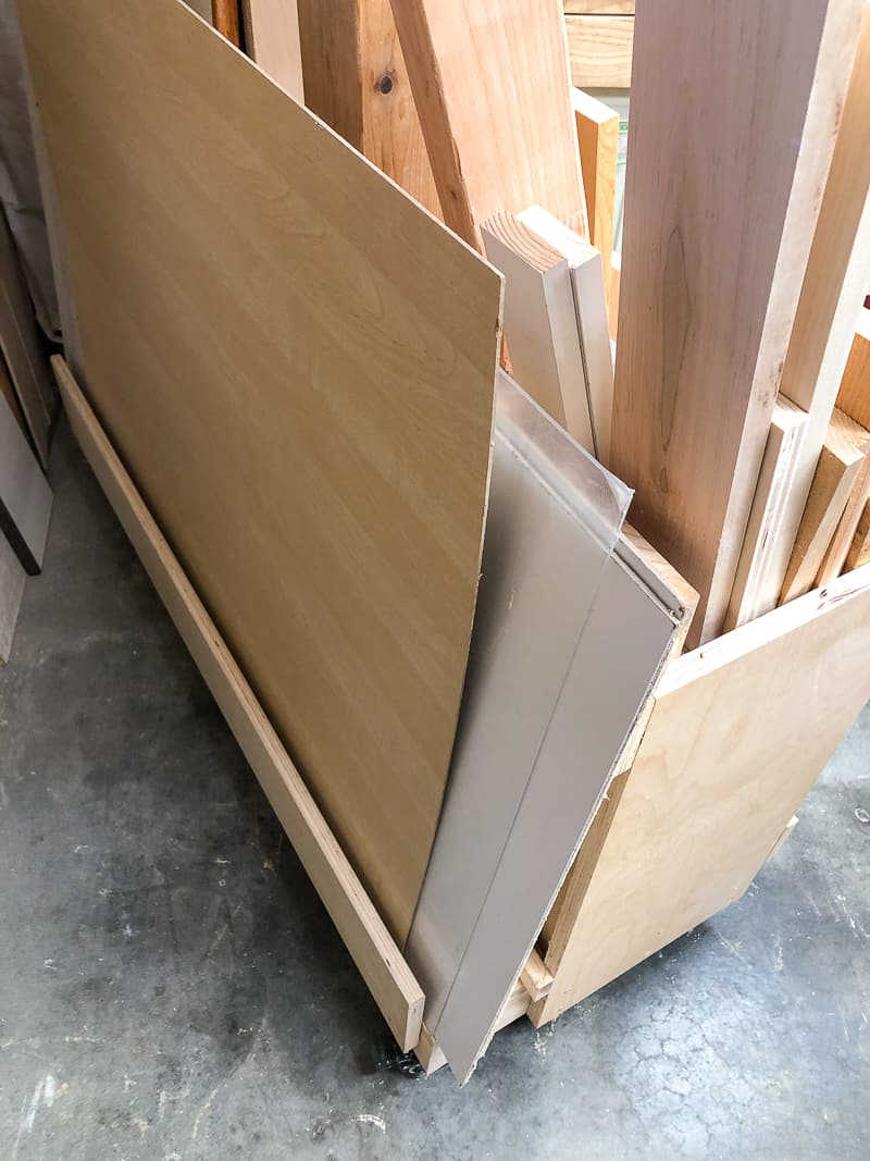 plywood sheets stored on the back of a DIY lumber cart