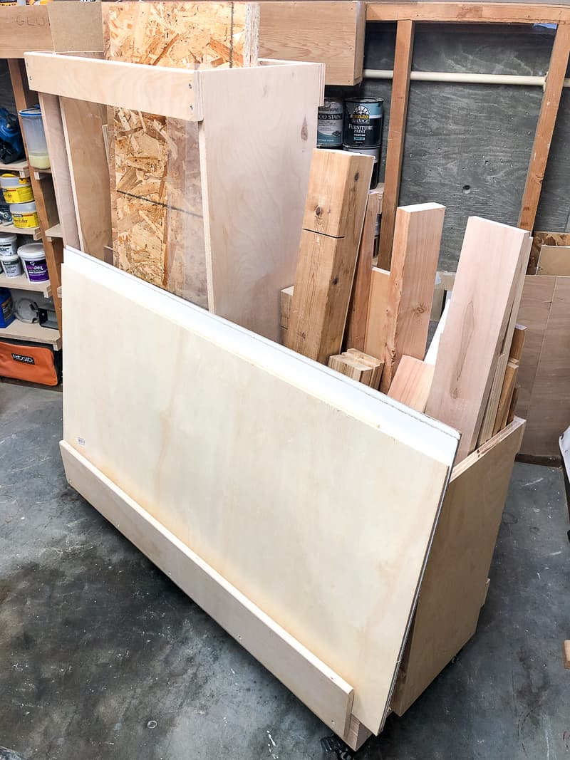 DIY lumber cart with plywood scraps on front