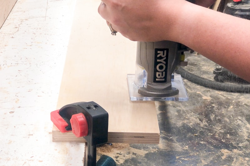 using a trim router with roundover bit on edges of lumber cart slats