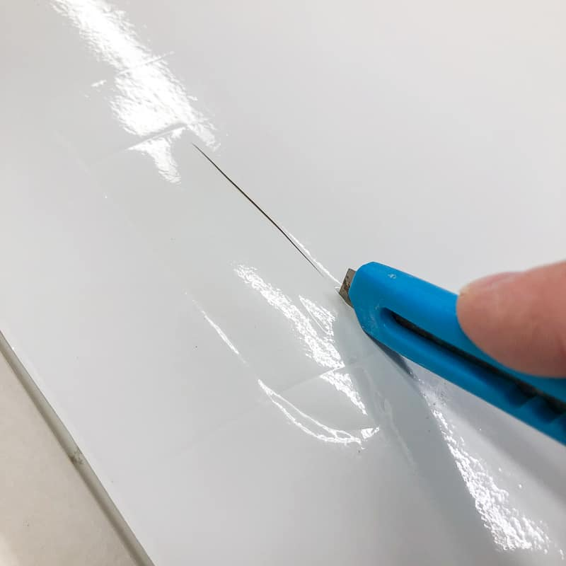 cutting hole for cabinet door hardware with a razor blade