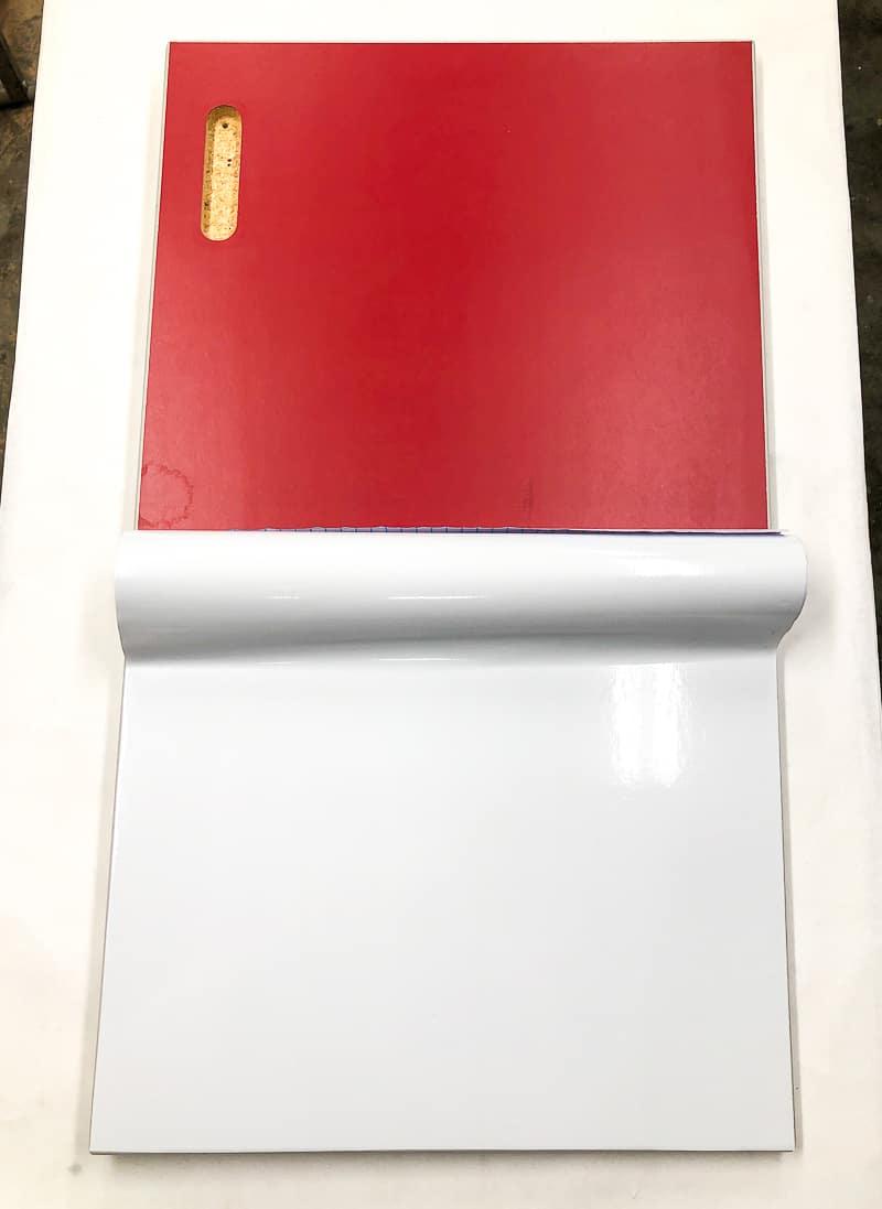 red cabinet door with contact paper applied halfway