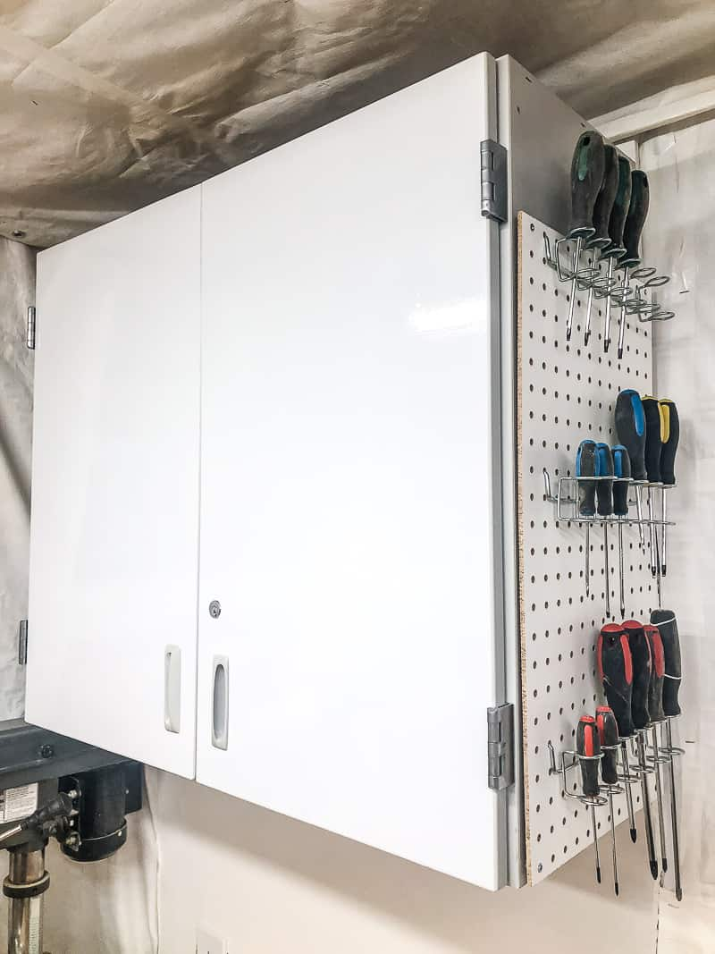 cabinet in workshop with pegboard on side