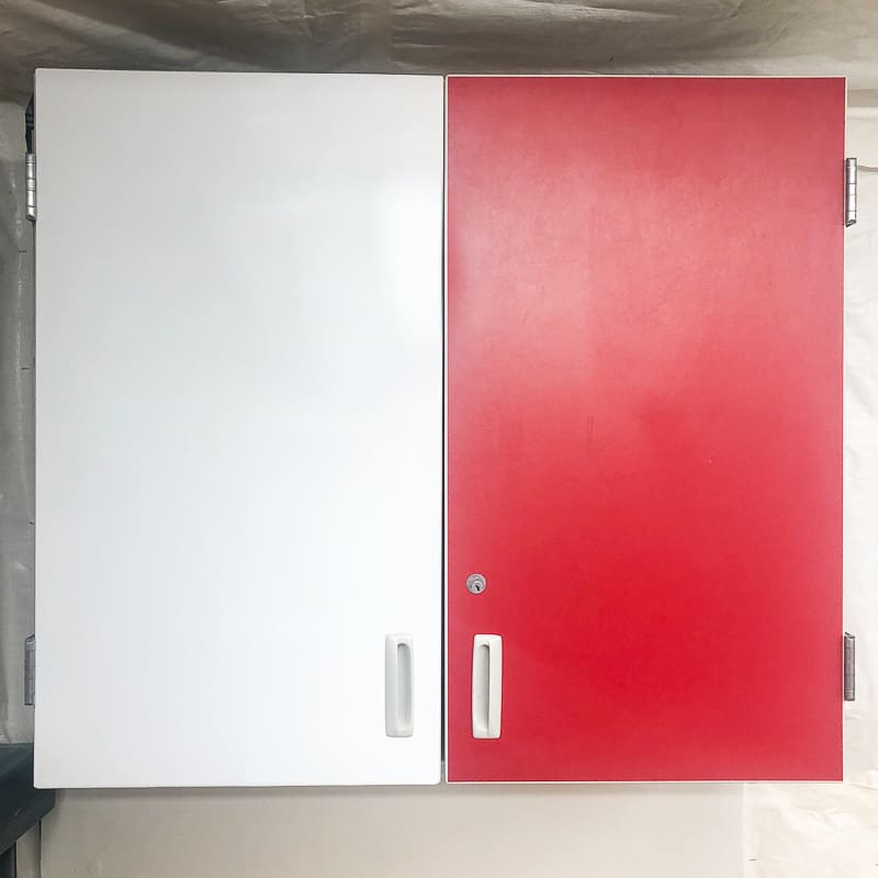 cabinet with one red door and one white contact paper covered side
