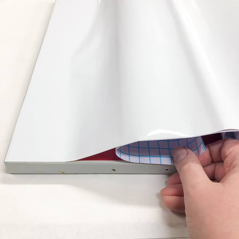 contact paper for cabinets being applied
