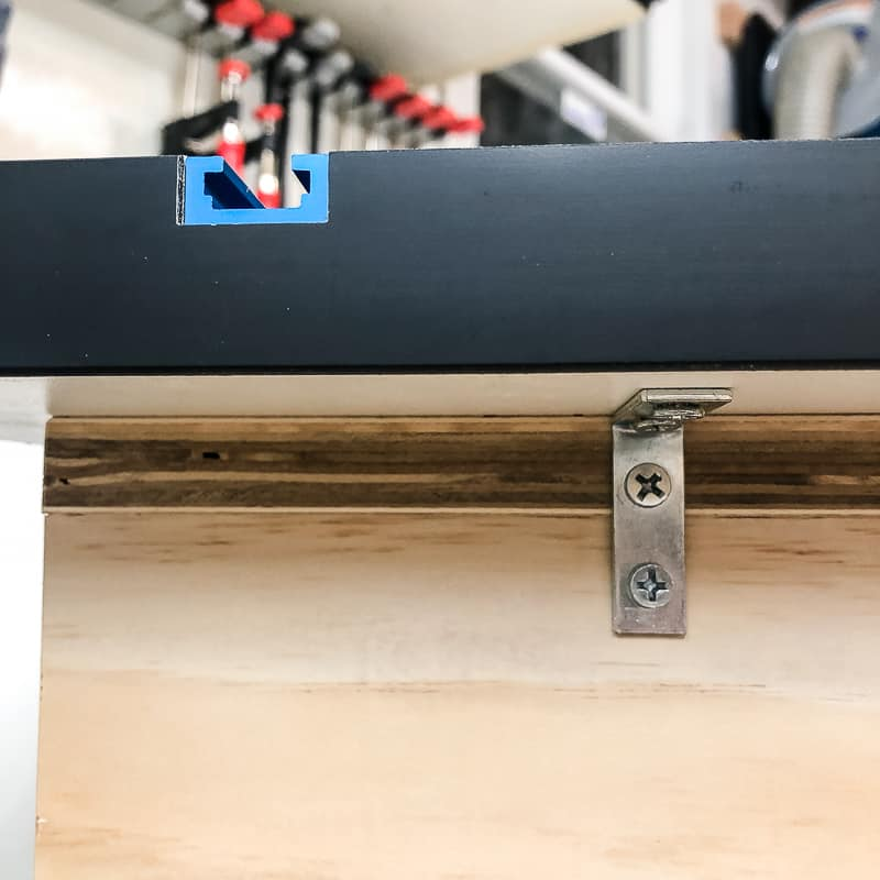 T track top attached to workbench with L brackets