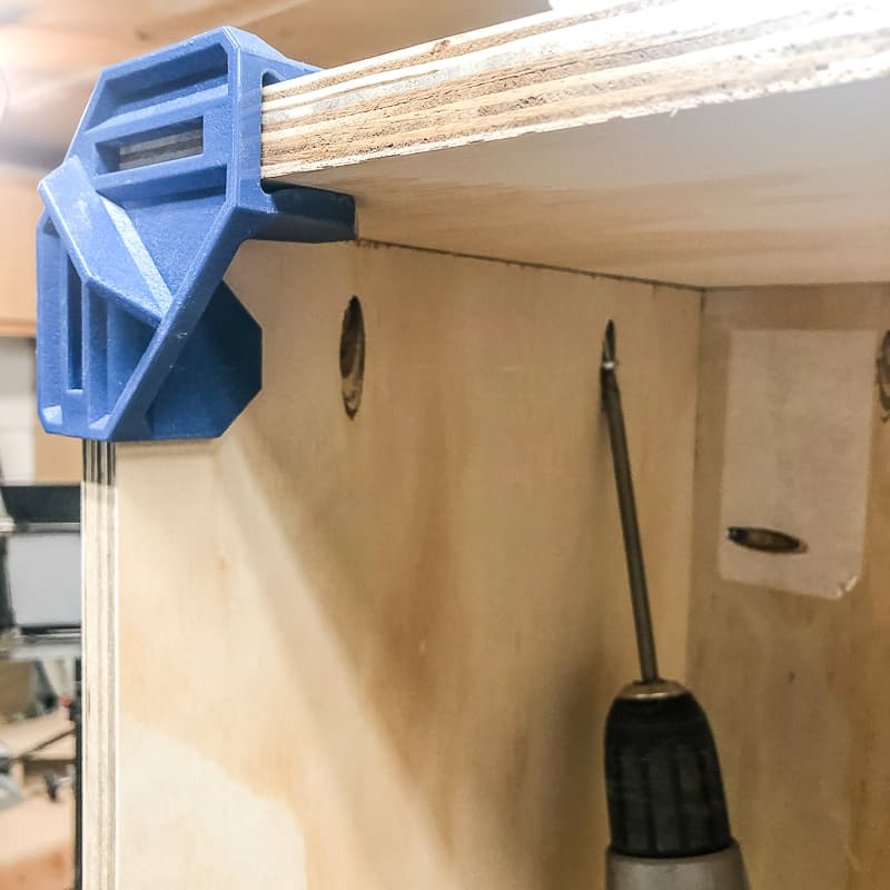 screwing top to sides of workbench with pocket hole screws