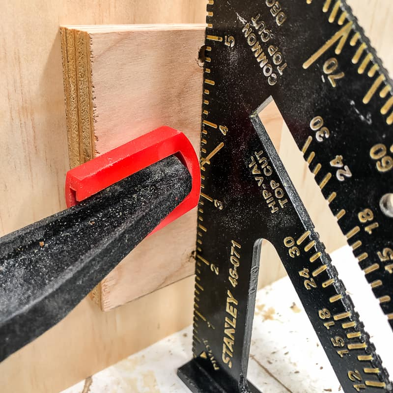 clamping scrap wood to side of DIY workbench for casters