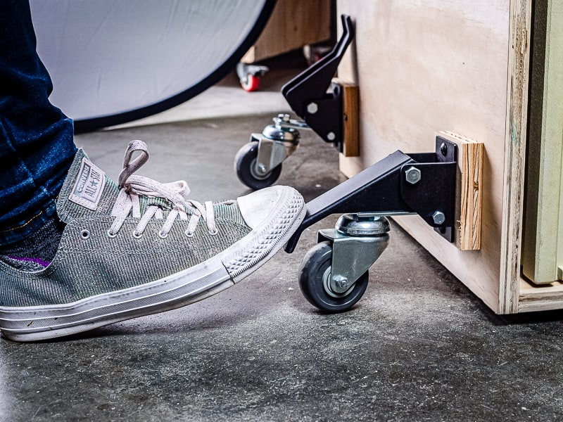 engaging workbench casters with toe of shoe