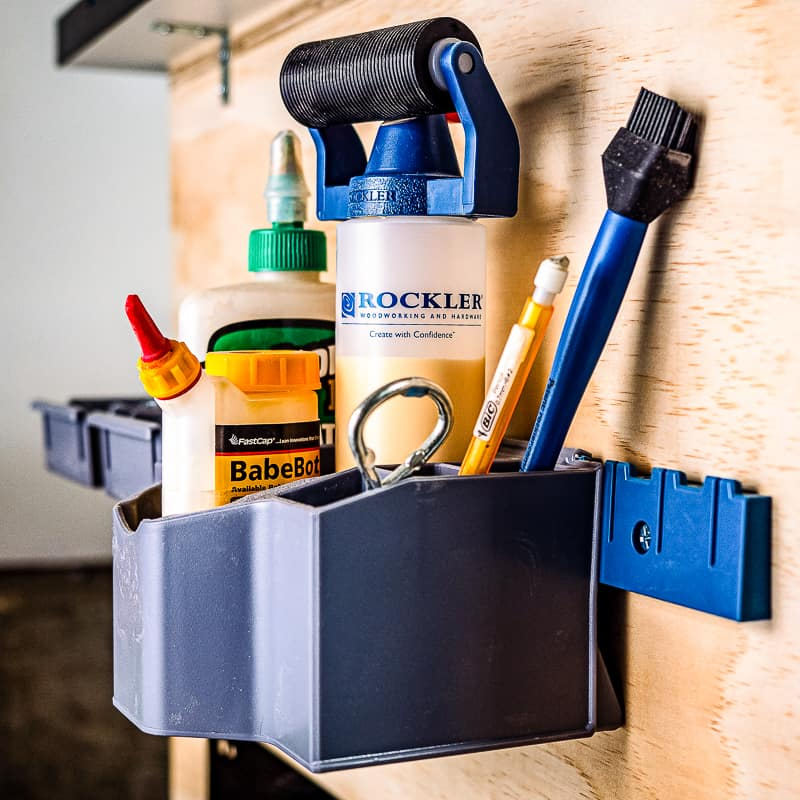 glue caddy and screw bins on side of mobile workbench