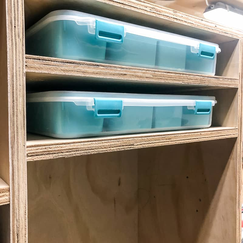 small parts bins with their own shelves in a DIY workbench