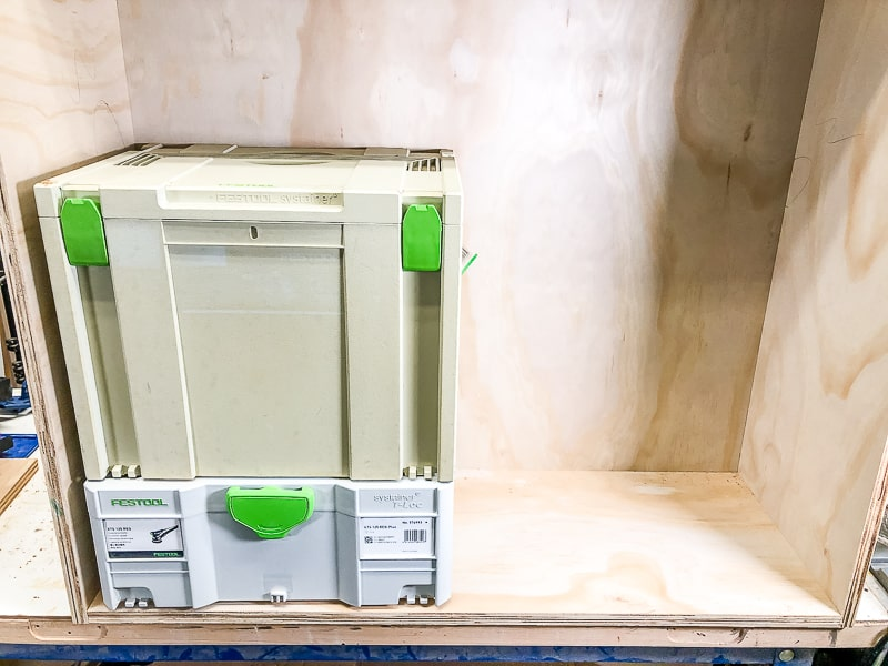 Festool systainers stacked inside DIY workbench