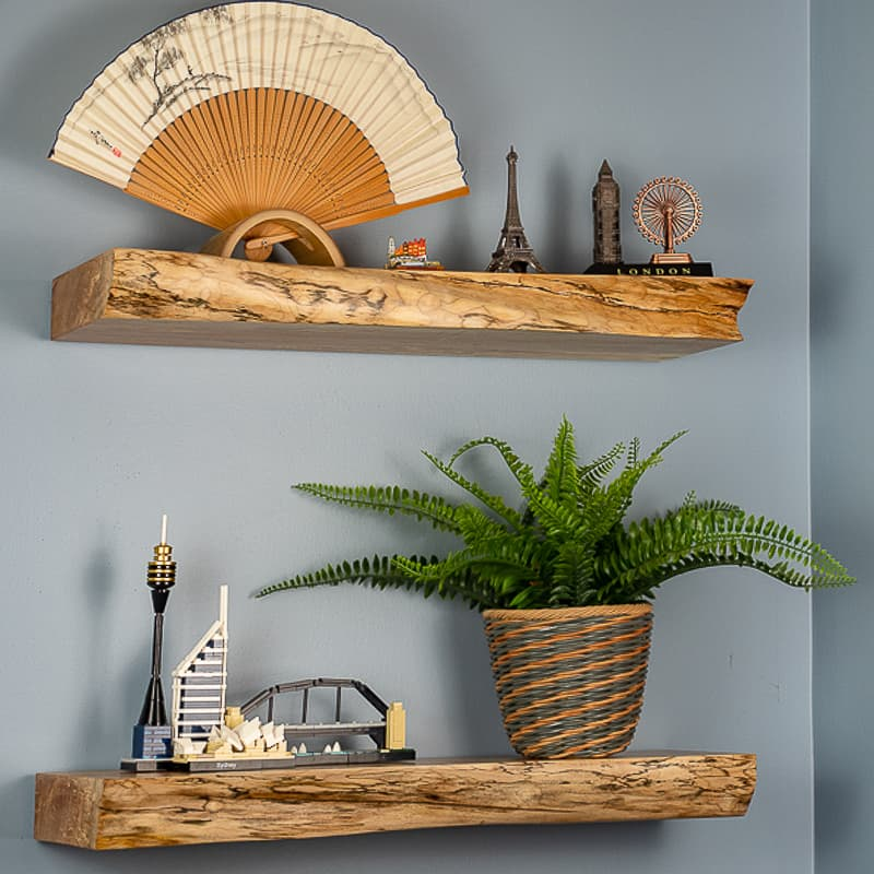 live edge floating shelves with travel souvenirs