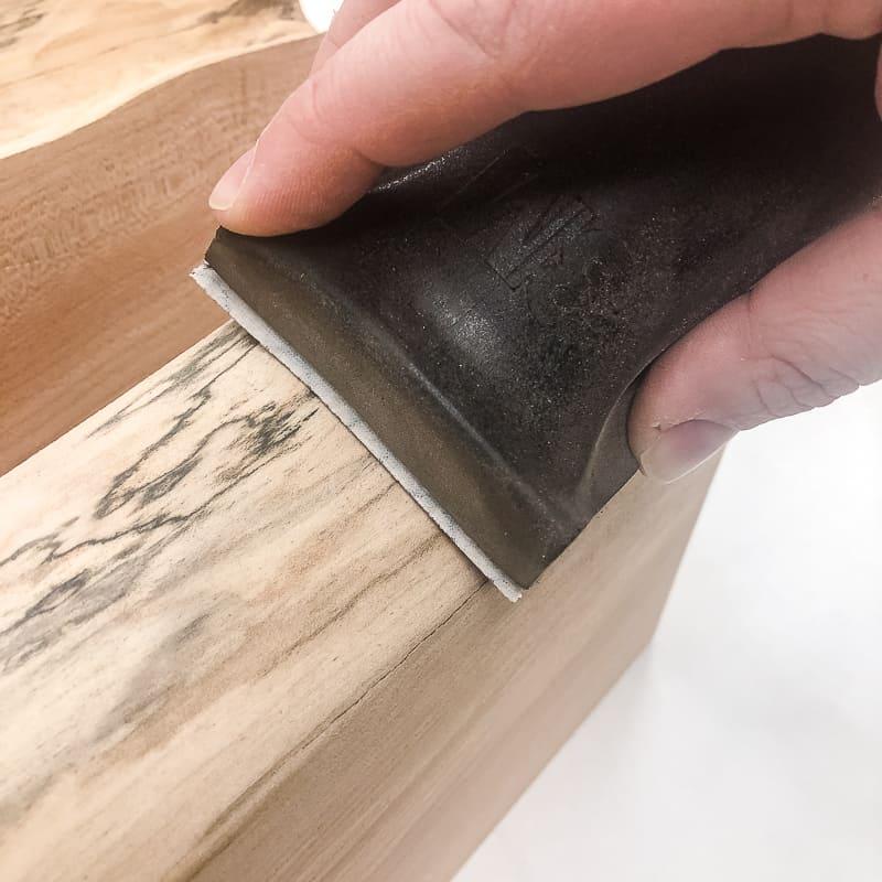 hand sanding live edge wood
