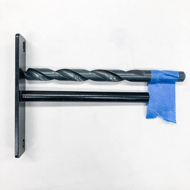 floating shelf hardware and drill bit with painter's tape marking depth